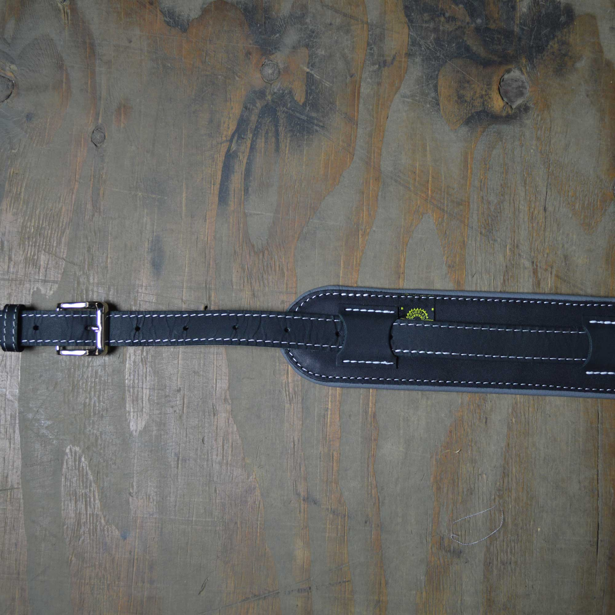 Vintage style guitar strap made with a topgrain leather top and an upholstery backing. Black & Grey